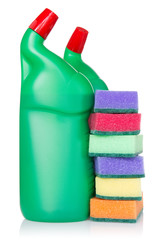 Plastic bottles of cleaning products and kitchen sponges
