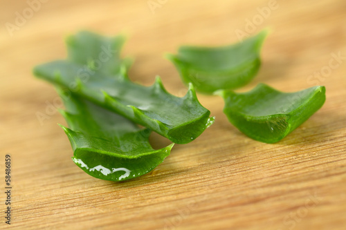 aloe vera on wooden surface