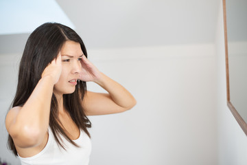 Young woman with a migraine headache