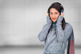 Composite image of beautiful model wearing winter clothes listen