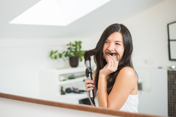 Woman styling her hair making a pretense moustache