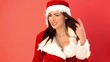 Happy and Sexy Woman in Santa Claus Costume Smiling and Waving