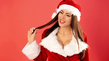 Sexy Girl in Santa Claus Costume Sending Sweet Kisses