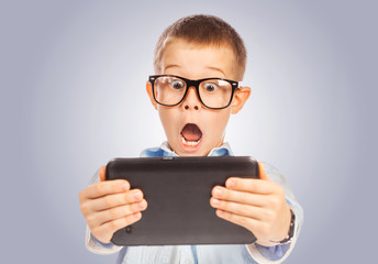confused boy with tablet. isolated