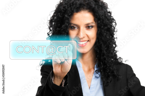 Beautiful businesswoman touching a contact button
