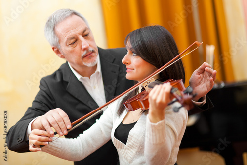 Music teacher with a female violist