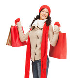 smiling woman in warm clothers with shopping bags