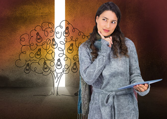 Composite image of pensive model wearing winter clothes holding