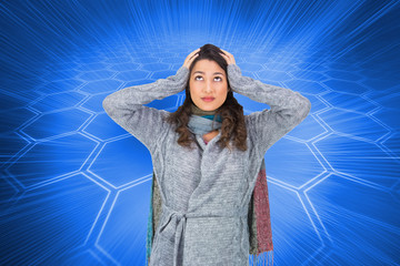 Composite image of anxious pretty brunette wearing winter clothe