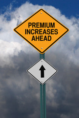 premium increases ahead roadsign