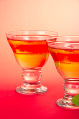 Two glasses with bright fruit jelly closeup