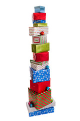 Tall stack of Christmas presents isolated on white