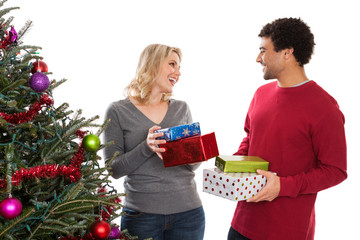 Christmas couple giving gifts