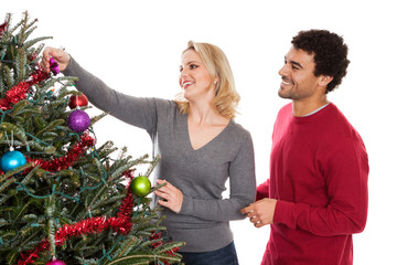 Christmas couple decorating tree