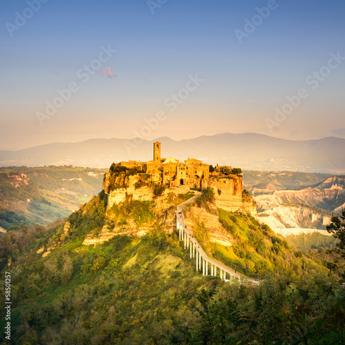 Civita di Bagnoregio landmark, aerial view on sunset. Italy