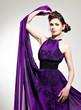 Beautiful fashion woman in purple long dress