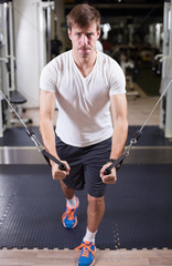 Young man working out in gym pecs exercise