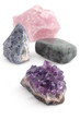 four big different gemstones (crystals) on white background
