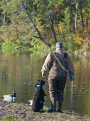 Goose hunter and his dog