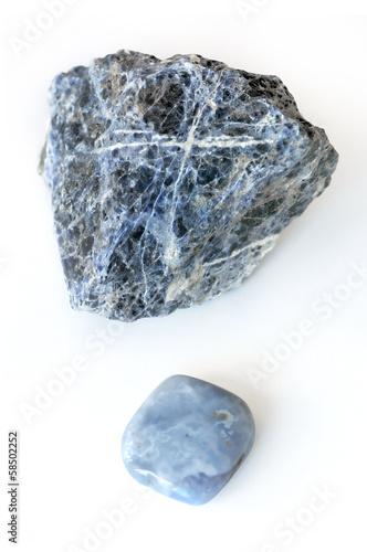 Leinwandbild Motiv Rough and smooth crystal on white background