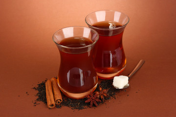glasses of Turkish tea, on brown background