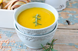 Pumpkin cream soup with lentils and rosemary