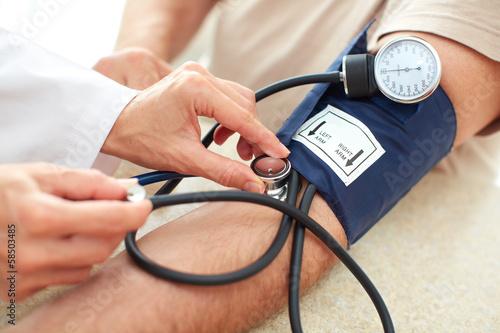 Leinwandbild Motiv Blood pressure measuring.