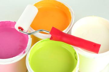 Set for painting: paint pots, paint-roller close up