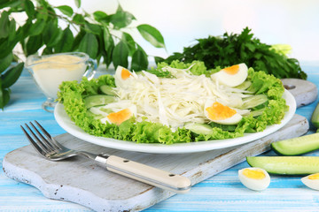 Delicious salad with eggs, cabbage and cucumbers