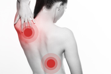 Young woman with shoulder and back pain
