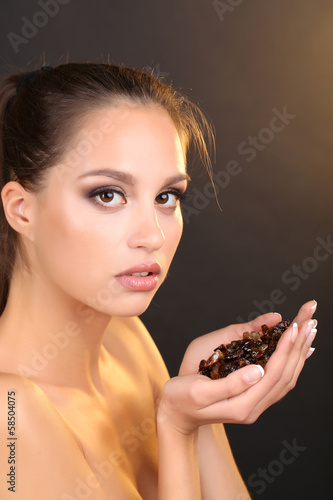 Portrait of beautiful young girl with caramelized sugar