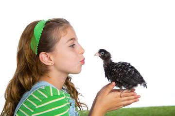 breeder hens kid girl rancher farmer kissing a chicken chick