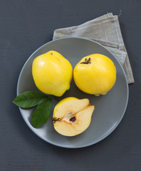 quince on a gray background