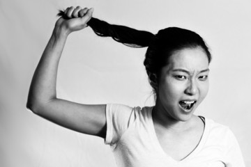 Young girl pulling her hair