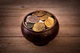 Pot of various coins