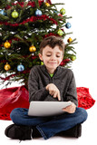Child playing on Tablet PC at Christmas