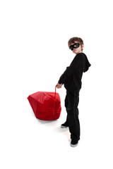 Child stealing Santa's Christmas sack