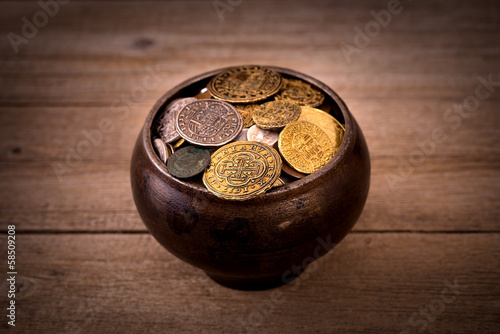 Pot of various coins