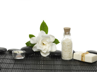 gardenia flowers ,candle, towel on wet black pebble