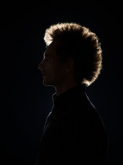 profile of man in black shadow
