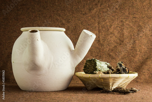 herbs and chinese clay pot