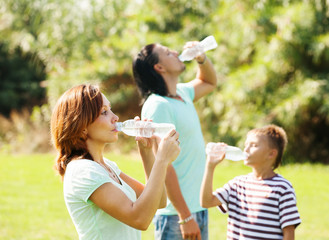 parents with  boy drinking clean water