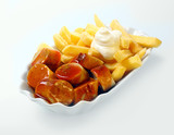Fototapety Currywurst with golden potato chips