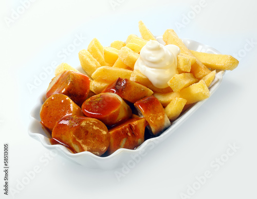 Staande foto Assortiment Currywurst with golden potato chips