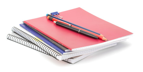 Notebook stack and pencils. Education and studies accessories.
