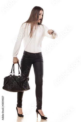 shocked young business woman looking at her watch