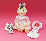 Eatable decorative doll and dog of marchpane poster