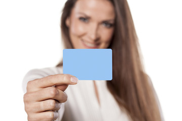 young business woman hold in her hand blank credit card