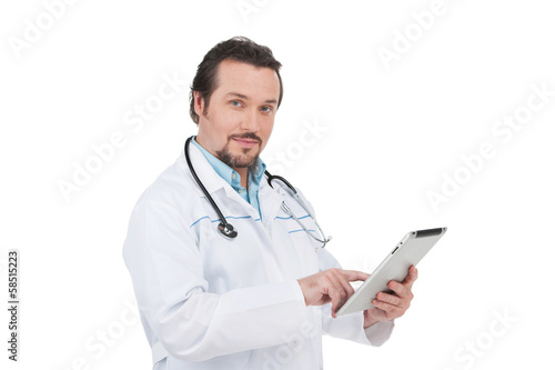 Portrait of Confident doctor with clipboard.