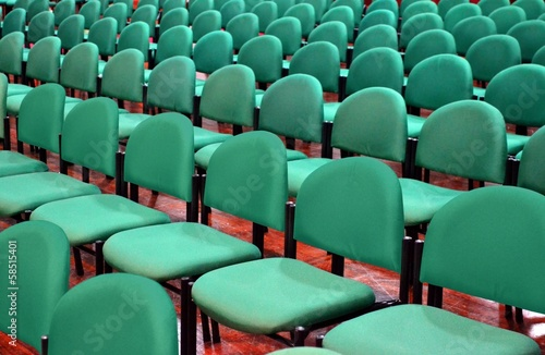 Rows of Green Chairs in a Seminar Hall
